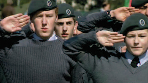 Two young cadets saluting