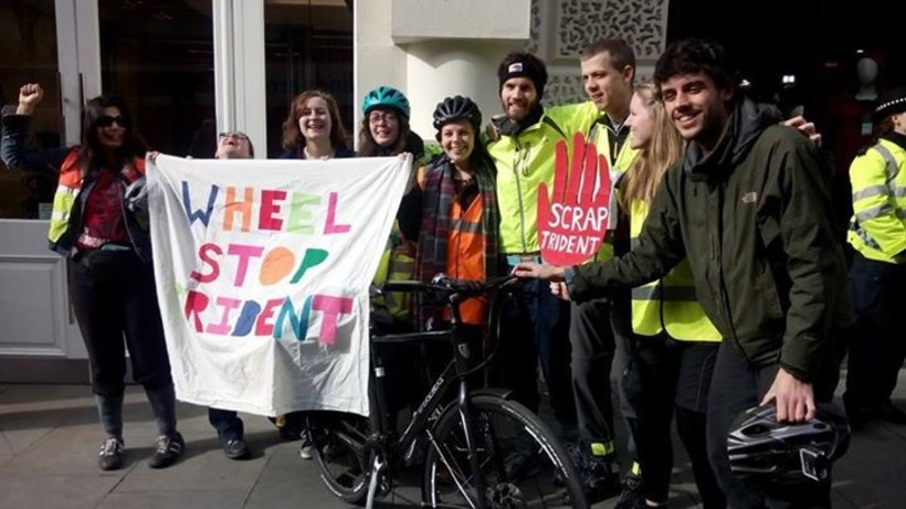 Young Quakers in front of banner reading Wheel Stop Trident