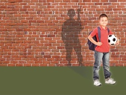 Schoolboy standing with a soldier shadow