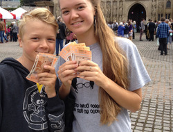 Young people holding Exeter pound notes at the launch