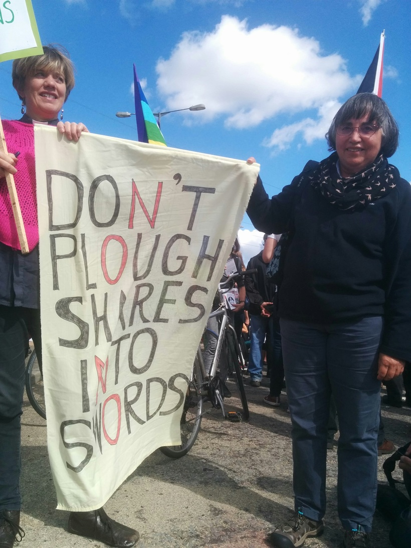 "Anna Botwright and a Friend hold a ""Don't plough shares into swords"" banner at the stop the Arms Fair Demonstration."