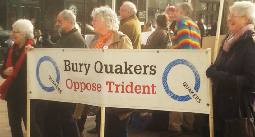 "Quakers holding the ""Bury Quakers oppose Trident"" banner during their silent vigil. Phot credit: Jill Segger"