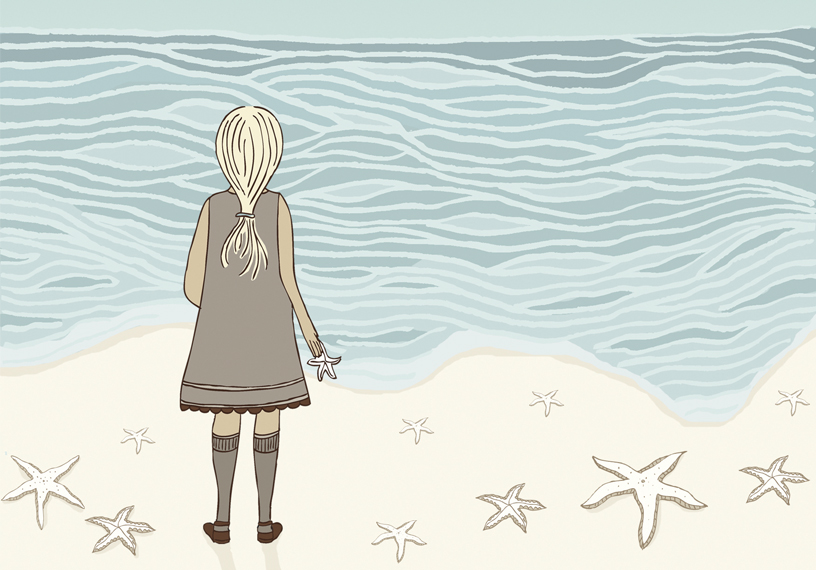 Young girl on a beach hurls one star fish back into the sea