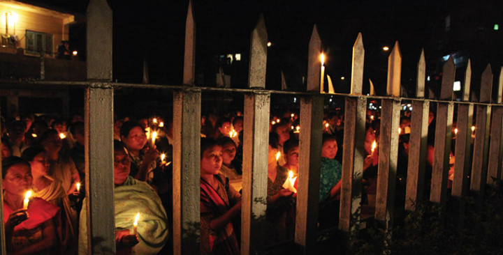 A candlelit vigil in South Asia.