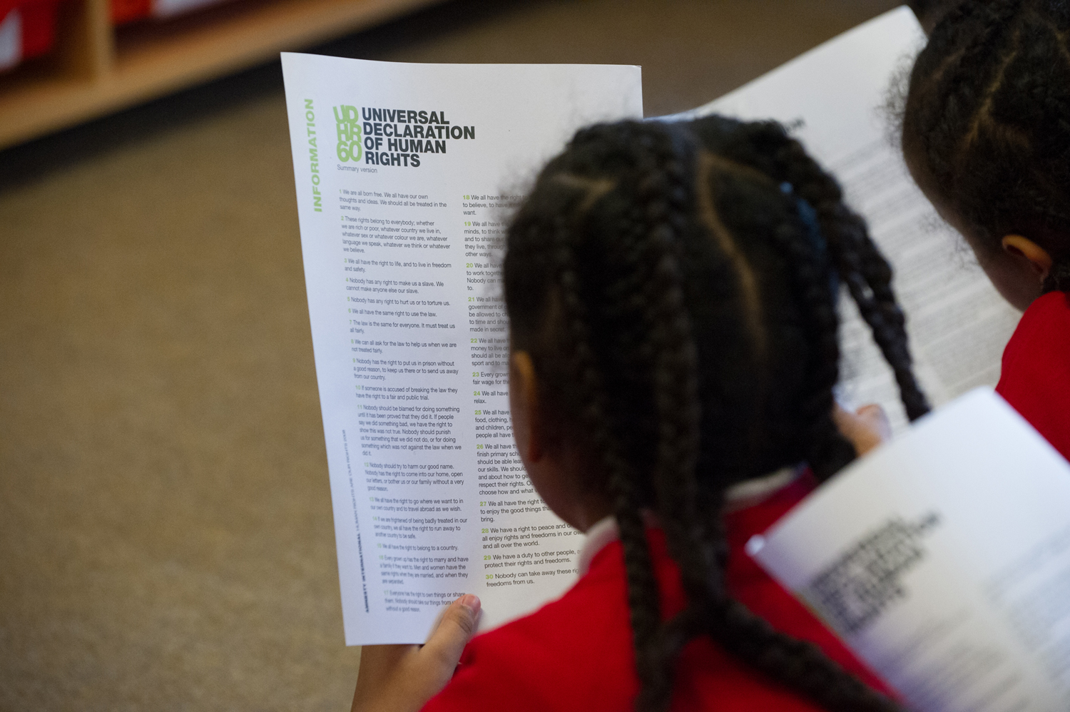 Children reading the Universal Declaration of Human Rights
