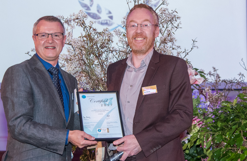 Paul Grey of Friends House Hospitalityreceives award from Ben Murray of CarbonSmart