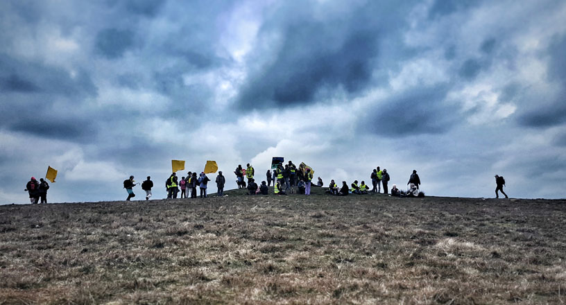 Quakers at the top of Pendle Hill, holding banners against fracking