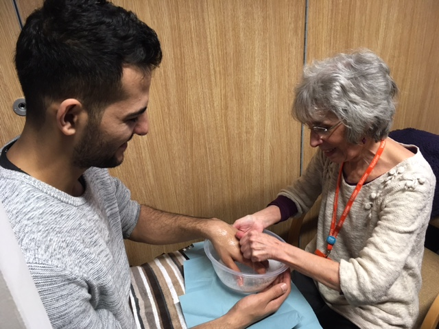 A member of Doncaster Meeting offers a hand massage to a person seeking Sanctuary in Britain