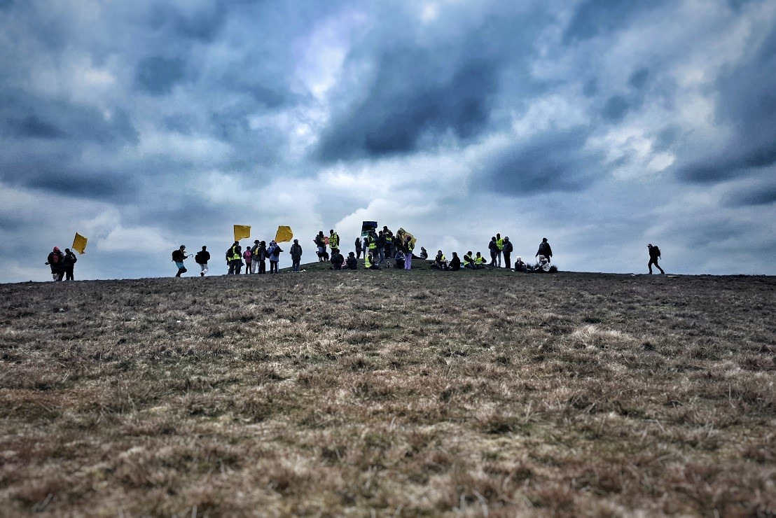 Quakers converge on Pendle Hill with banners and flags to protest plans of fracking in Lancashire