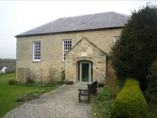 Substantially intact single-storey meeting house stone built with three big windows.
