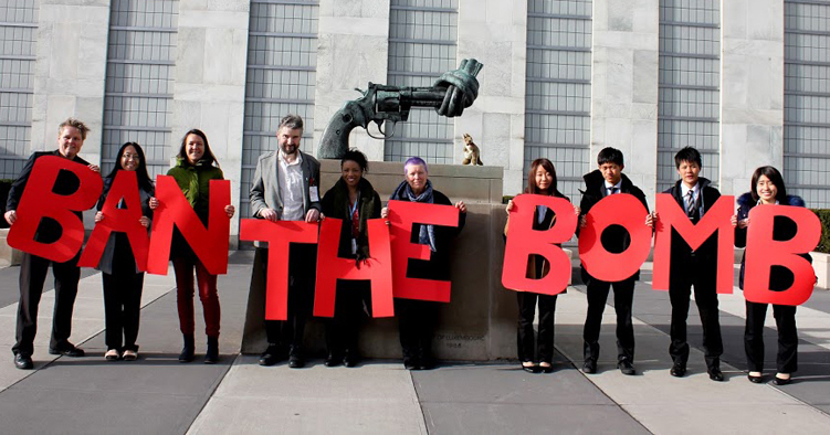 Campaigners hold huge red letters ban the bomb