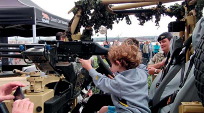 Children playing on military equipment at Liverpool Armed Forces Day, 2017