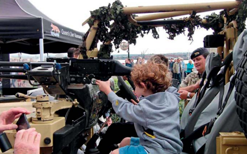 Children playing on military equipment at Liverpool Armed Forces Day, 2017. Photo: John Usher