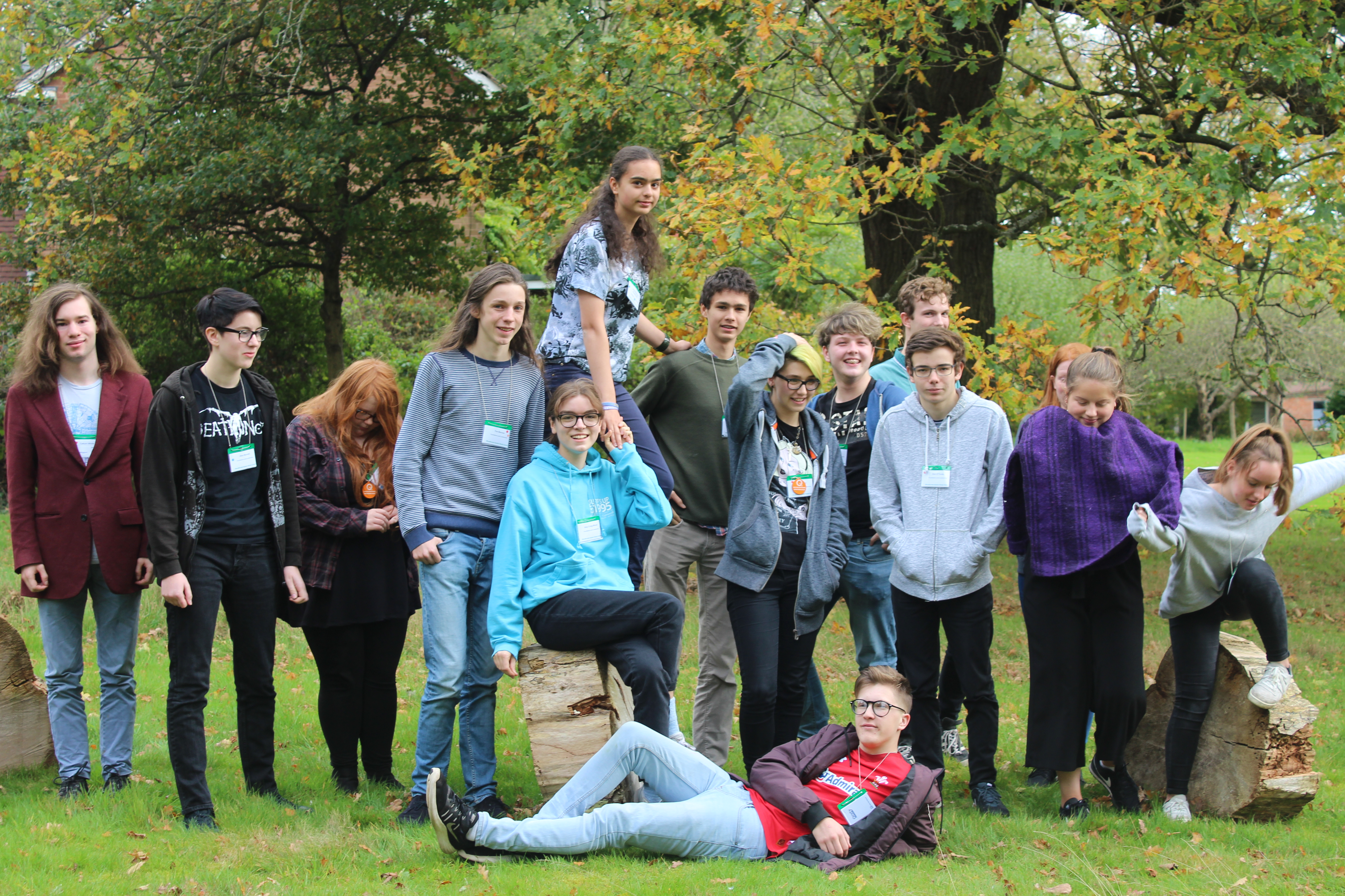 Group of young people posing in a garden in autumn