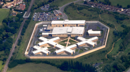 Aerial photo of a prison surrounded by green fields