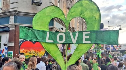 Green grenfell love heart placard