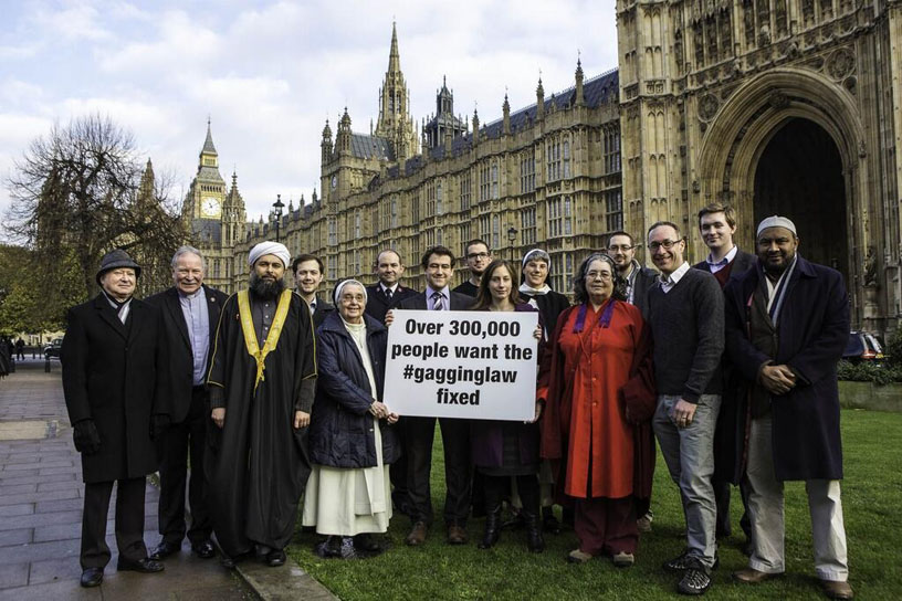 Dozen protest with placard on Lobbying Act, by HoP
