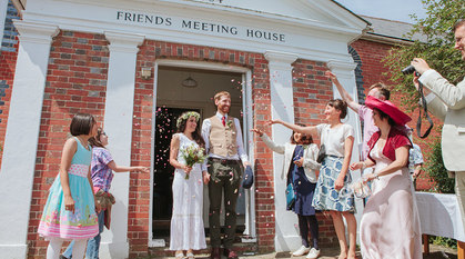 Newlyweds leaving their Quaker wedding ceremony. Photo: Amy Scaife