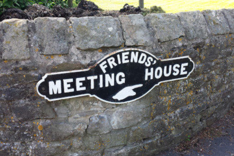 A white sign reads Quaker meeting house