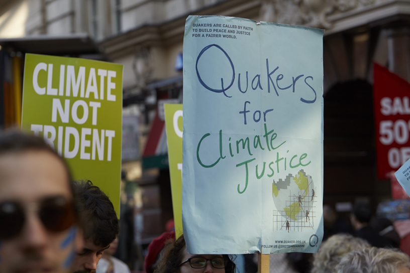 Placards say climate justice