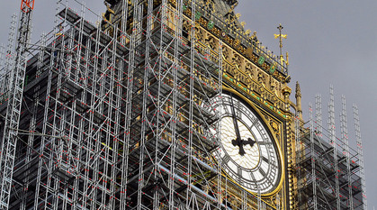 Close-up of one side of the clockface of Elizabeth Tower (Big Ben) surrounded by scaffolding