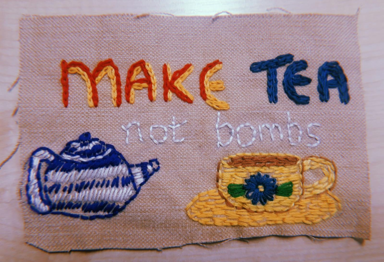 teapot stitches say make tea not bombs