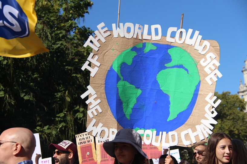 placard says if the world could see the world would change + globe