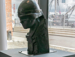 Image of the Pity of War statue.